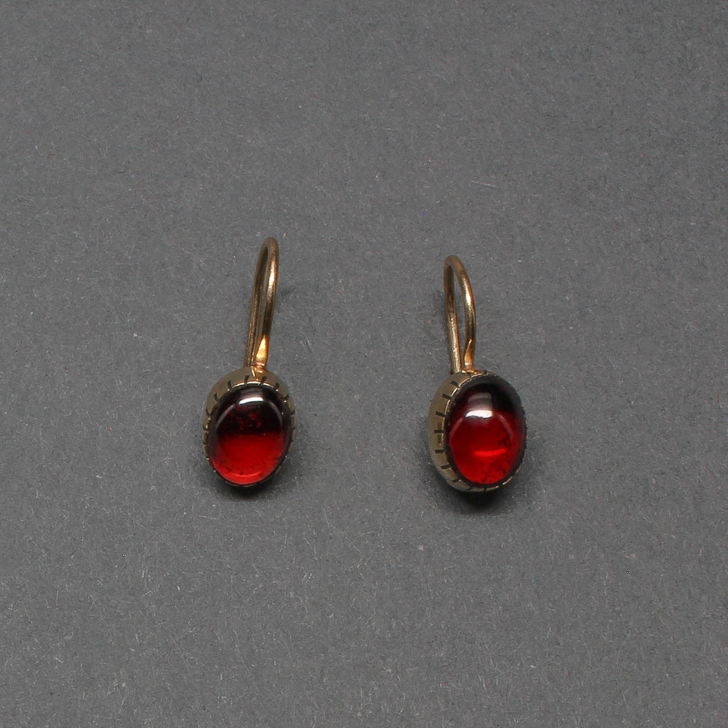 Small Yazzie Johnson Earrings of 14kt Gold Drops With Garnets