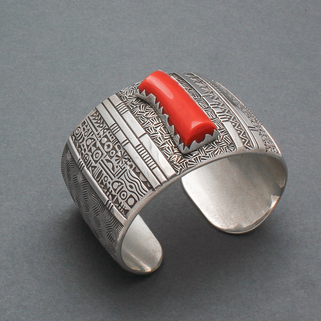 Norbert Peshlakai Wide Silver Stamped Bracelet With Coral Stone