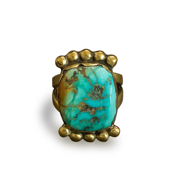 Vintage Tony Aguilar ring of Turquoise and Brass.jpg