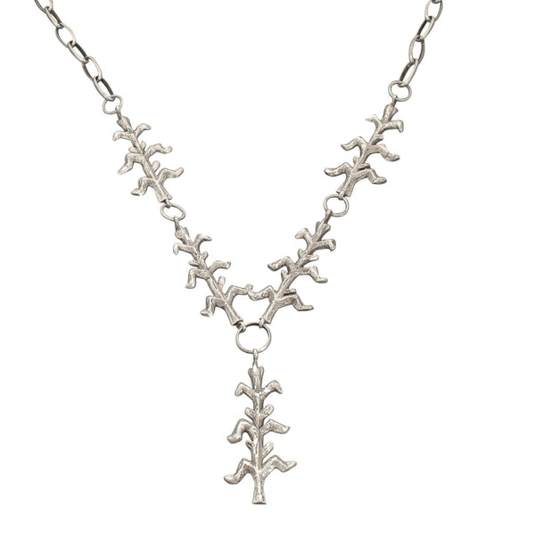 Ira Custer Corn Plant Necklace of Tufa Cast Silver.jpg