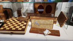 Handcrafted wooden games: checkers, cribbage boards and more.