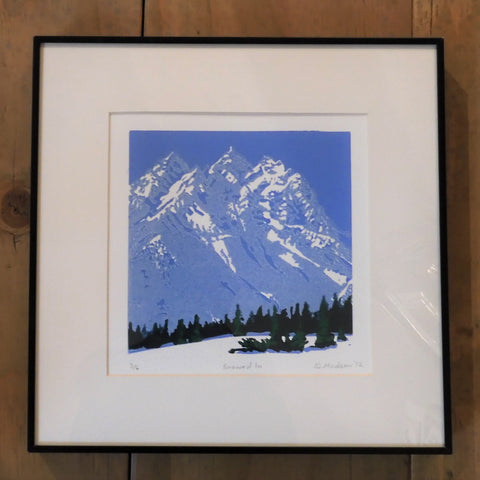"Original lithograph relief print by Ginny Madsen. 11' x 11"", white mat and narrow black frame. Grand tetons with snow and green pine trees in foreground"