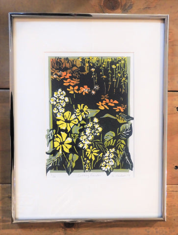 "Beautiful garden flowers in yellow, white and peach with green foilage, an original relief print by Ginny Madsen. 16"" x 12"". White mat and narrow frame"