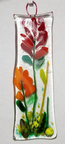 Long rectangle fused glass sun catcher Indian Paint Brush flower on clear glass.