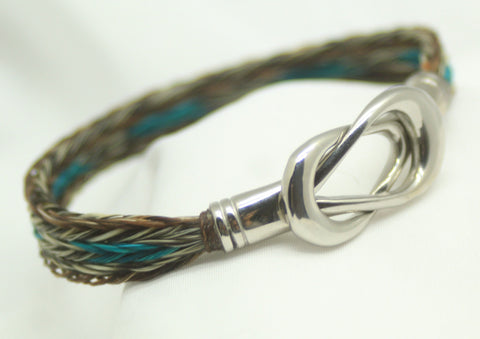 "hand braided horsehair in dark mix, teal and gray. magnetic reef knot stainless steel clasp. 7"" to 7.5"" wrist"
