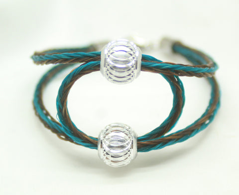 teal and brown braided horsehair. two aluminum beads.  hair through beads forms a beautiful circle as center point. stainless steel lobster clasp