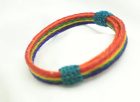 hand braided horsehair in rainbow lines. teal knots. adjustable bracelet