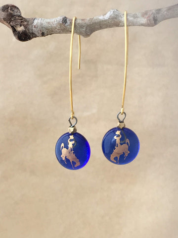 Blue fusted glass  dangles  with gold foil bucking bronco and gold faceted beads