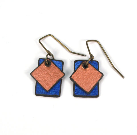 "Miss Libby Diamond Copper / Sapphire Rectangles Raw Hide Leather Earrings Artist: Dave Rowswell - Leather Artist  Rawhide from Tanned Leather  Miss Libby Diamond Copper / Sapphire Rectangles  Hand dyed vibrant colors on rawhide   Antique colored ear wires   Matt Finish   1/2"" Wide x 3/4"" Long x 1/16"" Deep  Great with a pair of jeans or with an out on the town outfit"