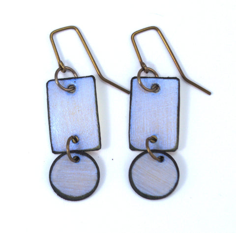 "Lazy Blue Circles / Rectangle Raw Hide Leather Earrings Artist: Dave Rowswell - Leather Artist  Rawhide from Tanned Leather  Blue Circle  over Rectangle  Hand dyed vibrant colors on rawhide   Antique colored ear wires   Matt Finish   1/2"" Wide x 1 1/4"" Long x 1/16"" Deep  Great with a pair of jeans or with an out on the town outfit"