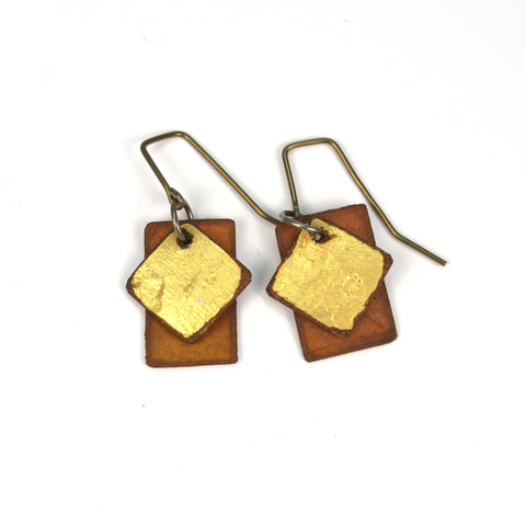 "Miss Libby Diamond Gold / Brown Rectangles Raw Hide Leather Earrings Artist: Dave Rowswell - Leather Artist  Rawhide from Tanned Leather  Miss Libby Diamond Gold / Brown Rectangles  Hand dyed vibrant colors on rawhide   Antique colored ear wires   Matt Finish   1/2"" Wide x 3/4"" Long x 1/16"" Deep  Great with a pair of jeans or with an out on the town outfit"