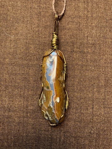 Opalized petrified wood pendant . transparent agate with milky white common opal highlights and chocolate brown petrified wood pendant
