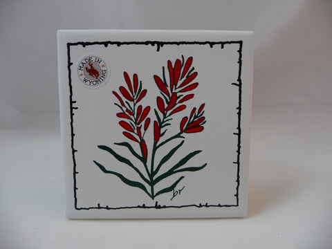 Tile functional or decorative coaster. Indian Paint Brush flower screen printed on a tile. Barbed wire accent border.