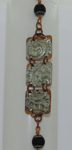 "Moulton Silver Copper Swirl Bracelet Artist: Jackie Olaveson, Metalsmith Moulton Silver stamped with a swirls on copper / copper chain and black bead accents   7 1/2"" Long  X  7/8"" Wide X 1/16"" Deep  Three silver copper links / black beads and copper magnetic clasp  Nice with a laid back outfit or a nice dress out for the evening  Please note, each jewelry piece is custom designed by the Artist , with a slight variation between each piece"