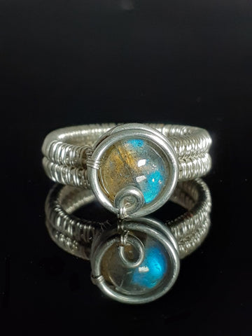 9 mm labradorite stone hand wrapped in silver colored artistic wire. Size 6 ring