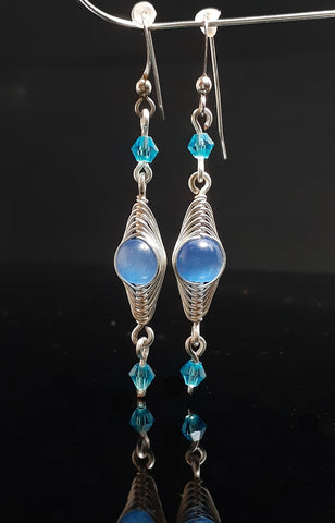 blue cat's eye stone with Swarovski crystal bead wrapped in silver artistic wire. sterling silver ear wires