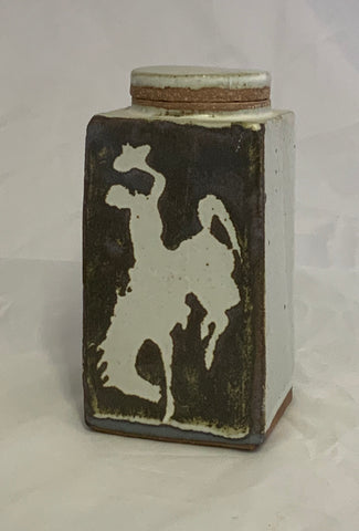 "Bucking Horse lidded rectangle ceramic jar . White Steamboar, the bucking horse on brown background. Measures, 2.75' x 2.75"" x 6"""