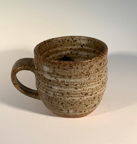 "Speckled Tan Glazed Stoneware Mug Muffy Moore: Ceramic Potter Tan speckled glaze with hint of dark brown   Nice size handle and good size mug overall   3.5"" Long  x 3.5"" Wide x 4"" Tall  Beautiful hand thrown stoneware mug  Dishwasher, oven and food safe  Great for kitchen storage  Please note Items are handmade by Artist and there is a slight variation from piece to piece"
