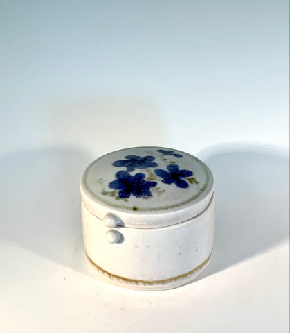 "White Porcelain Blue Flower Round Box Muffy Moore: Ceramic Potter White  fine China porcelain round box with matching lid  Nice size round what not box in white and blue colors with flowers    4"" Long  x 4"" Wide x 3"" Tall  Beautiful hand thrown fine china porcelain box Dishwasher safe  Great for kitchen storage  Please note Items are handmade by Artist and there is a slight variation from piece to piece"