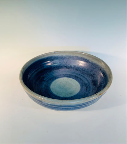 "Grey / Wide Blue Stripe Stoneware Bowl Muffy Moore: Ceramic Potter Grey / Wide Blue Stripe Stoneware Bowl  Nice size bowl in gray tone with wide blue stripe accent   10"" Long  x 10"" Wide x 3"" Tall  Beautiful hand thrown stoneware bowl  Dishwasher safe, oven and food safe   Great for kitchen storage  Please note Items are handmade by Artist and there is a slight variation from piece to piece"