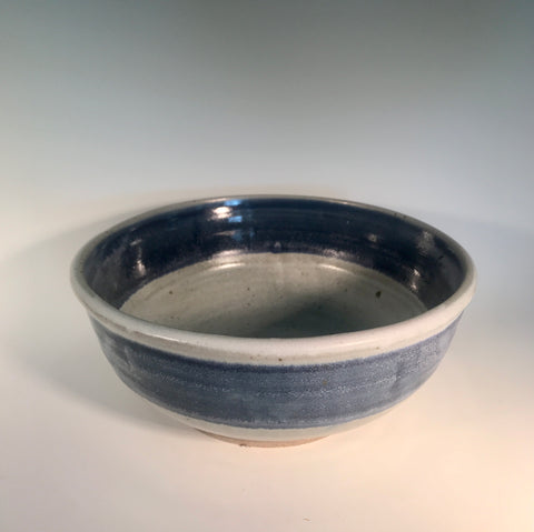 "Small White / Blue Striped Stoneware Bowl Muffy Moore: Ceramic Potter Small white stoneware blue striped Bowl  white bowl body with blue striped rim tone accents   9"" Long  x 9"" Wide x 4"" Deep  Dishwasher safe, oven and food safe  Great for fruits, vegetables and other food products   Please note Items are handmade by Artist and there is a slight variation from piece to piece"