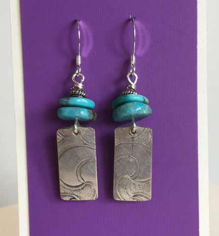 "Embossed Silver Plate Rectangles With Turquoise Wafer Earrings Artist: Terry Kreuzer  Recycled Embossed Silver Plate with Two Turquoise wafers  1"" Long x 3/8"" wide  Stirling Silver ear wires  Please note, the jewelry is custom designed by the Artist , with a slight variation between each piece"