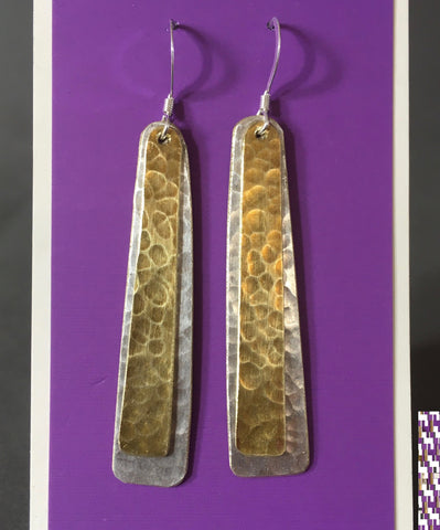 "Hammered Silver Plate And Brass Strip Earrings Artist: Terry Kreuzer  Strip of Hammered Silver Plate with Strip of Hammered Brass lying on top  1 3/4"" Long x 1/4"" wide  Stirling Silver ear wires  Please note, the jewelry is custom designed by the Artist , with a slight variation between each piece"
