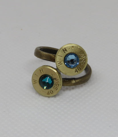 "Double Cut Bullet adjustable Ring Jackie Olaveson, Metal-smith Bullet adjustable ring Double bullet ends Light Blue/dark blue Swarovski Crystals in bullet ends 3/8"" x 3/4"" x 7/8"" measurements Look sleek on the hand Please note, the jewelry is custom designed by the Artist , with a slight variation between each piece"