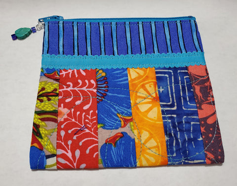 "Multi Colored Stripped Zipped Coin Purse Glenda Haley, Fabric/woodworker Artist Coin Purse is 5"" x 1/8"" x 4 3/4"" Coin Purse has 6 stripped of fabric with different colors Coin purse zips Coin purse is cotton fiber Hand Wash Please note, the coin purses are a custom designed by the Artist , with a slight variation betwe…"