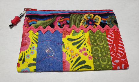 "Multi Colored Ribbon Zipped Coin Purse Glenda Haley, Fabric/woodworker Artist Coin Purse is 5 1/2"" x 1/8"" x 3 3/4"" Coin Purse has multi colored stripes with pink ribbon across it Coin purse zips Coin purse is cotton fiber Hand Wash Please note, the coin purses are a custom designed by the Artist , with a slight variati…"