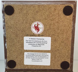 Cork bottom of floor tile trivet with felt protectors and artist information and care informationt