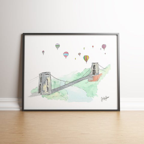 Framed painting of Clifton suspension bridge in watercolour with balloons over the bridge