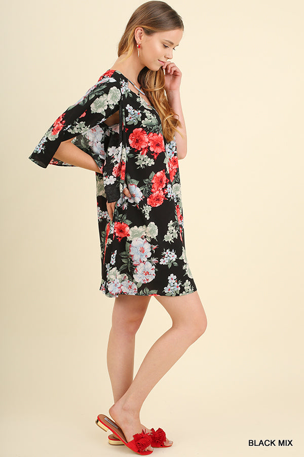 Black and floral criss cross neckline  dress side