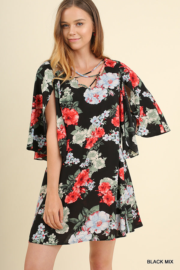Black and floral criss cross neckline dress front