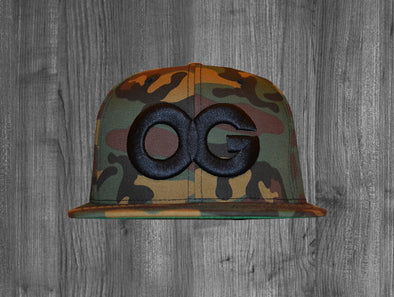 OG SNAP BACK.  WOODLAND CAMO / BLACK