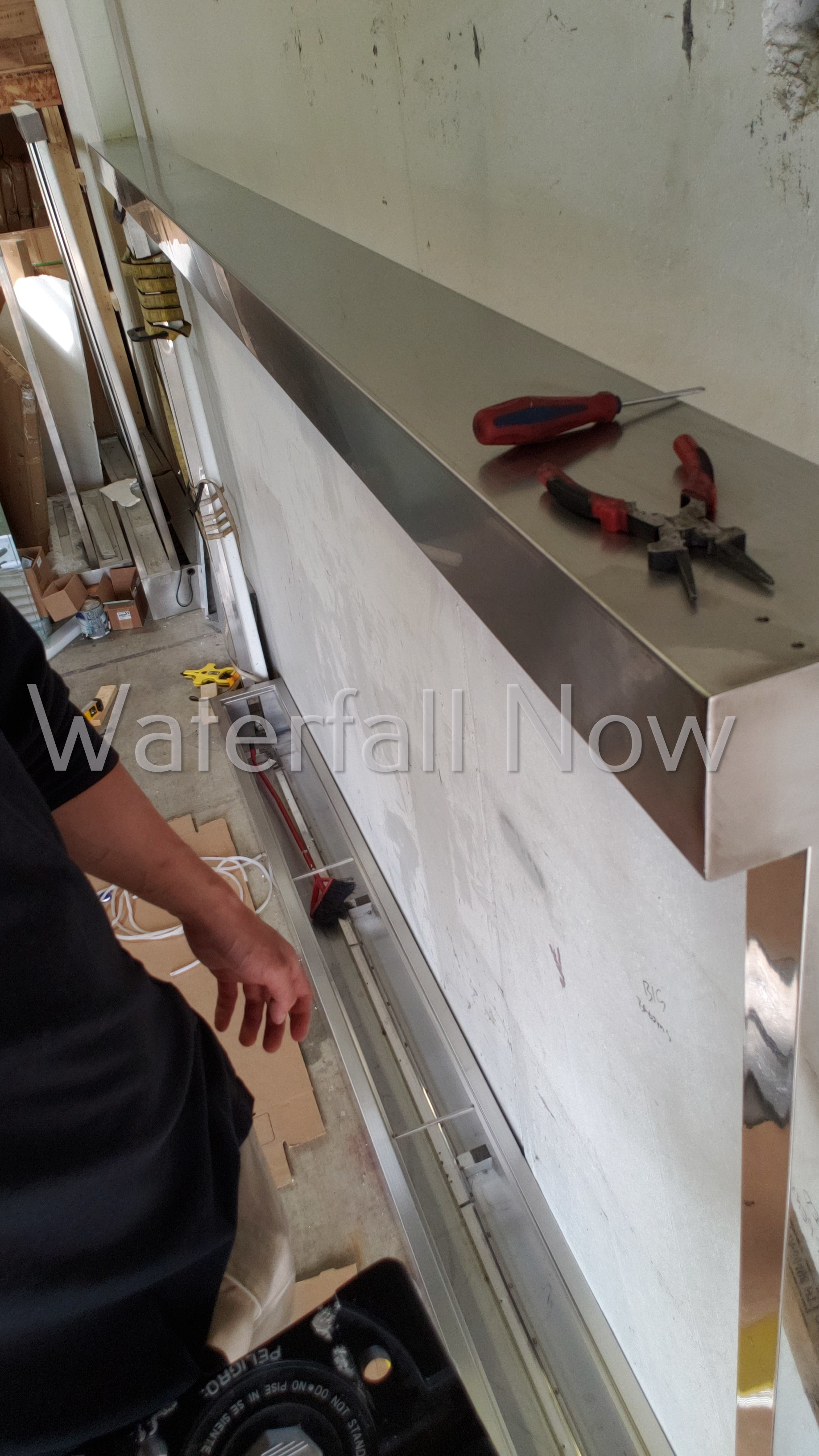 Custom Waterfall Components - Frameless kiln formed glass panels - 316 brushed stainless steel