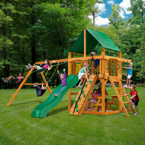 Gorilla Chateau Wooden Swing Set with Green Vinyl Canopy, Rock Climbing Wall, and Alpine Wave Slide