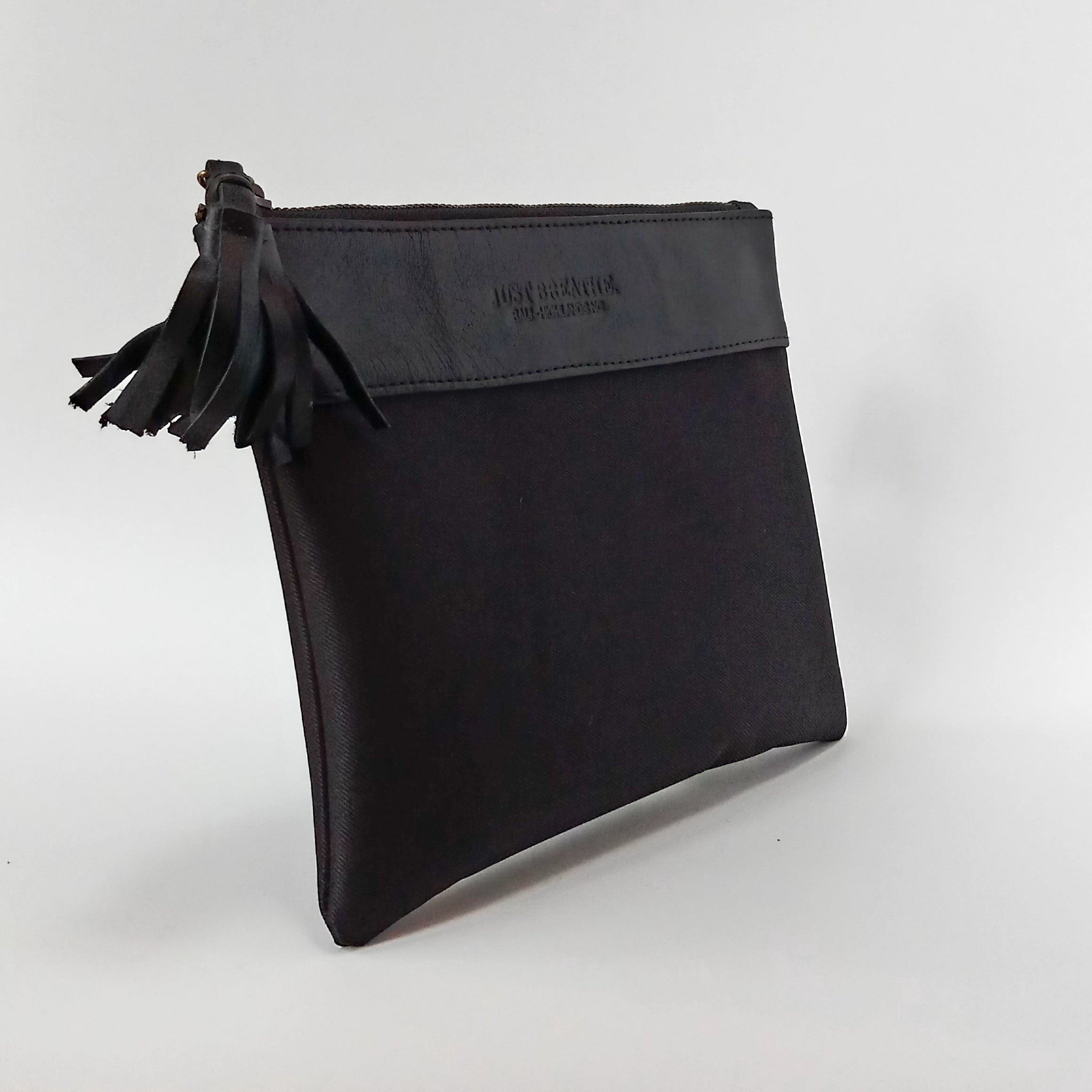 black leather and nylon pouch makeup bag