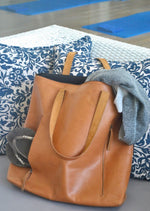 Brown leather gym and travel tote bag