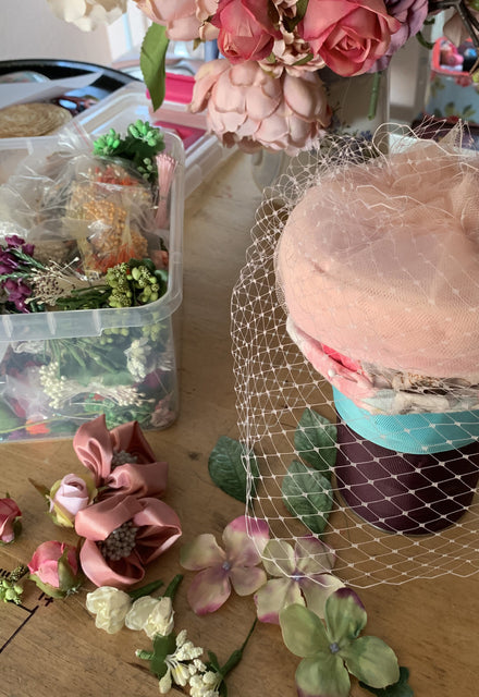 Powder pink Coquette pillbox hat with birdcage veil