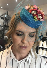 Jen wearing her teal silk Coquette pillbox hat with pink and red flowers