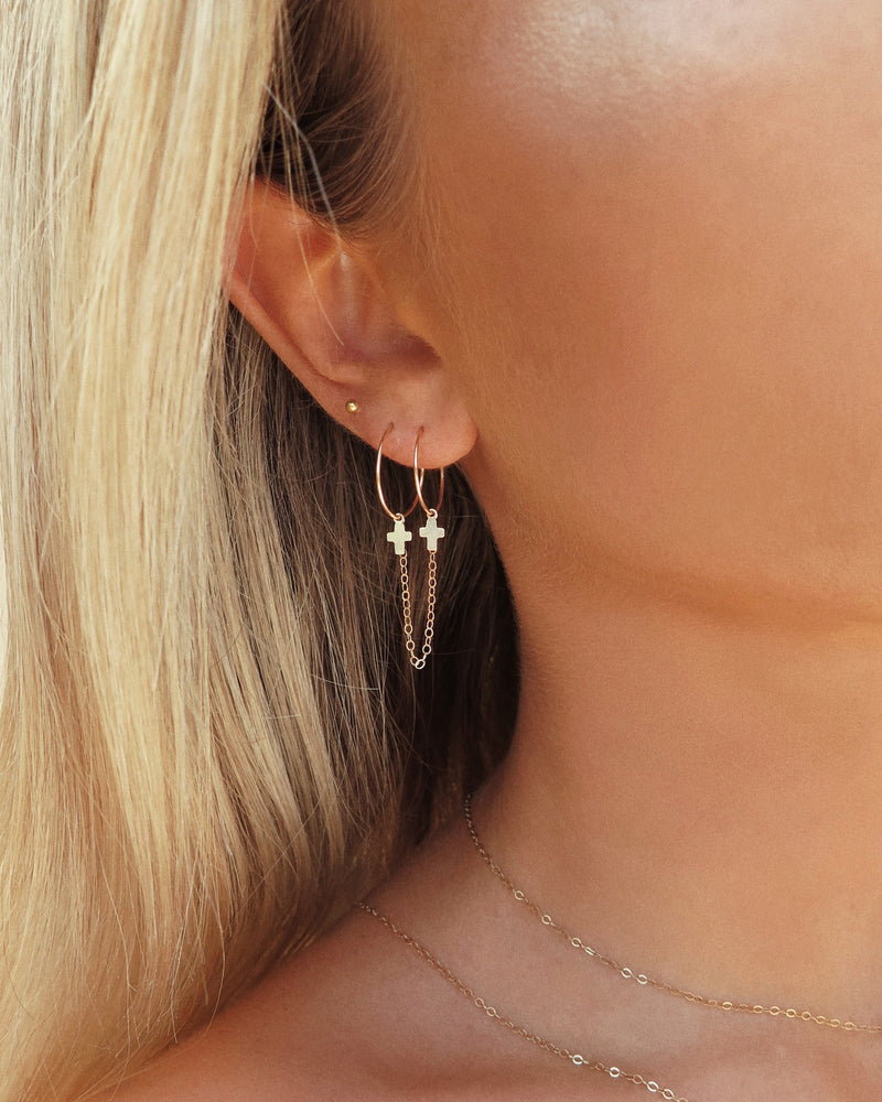 DOUBLE PIERCING CROSS HOOP EARRINGS