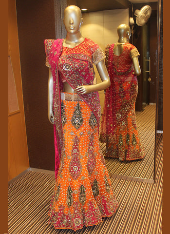 Women's Net Fabric & Orange Color Pretty A Line Lehenga Style With Crystals Stones Work Dupatta