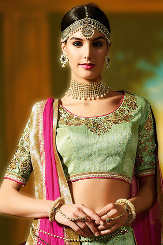 Impressive Green Silk Embroidered Lehenga With Embroidered Matching U Neck Choli