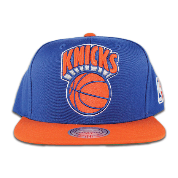 www.levels613.com Class: Mitchell & Ness New York Knicks Men's Snapback Hat Fabric: 80% Acrylic/20% Wool Detail Print: Raised Embroidered Front Logo Color: Royal Blue, Orange Size: O/S Comfortable Affordable Authentic Unique High-Quality Long Lasting Fresh All-Season Summer Fall Winter Spring Gear Urban Streetwear Men Women Unisex