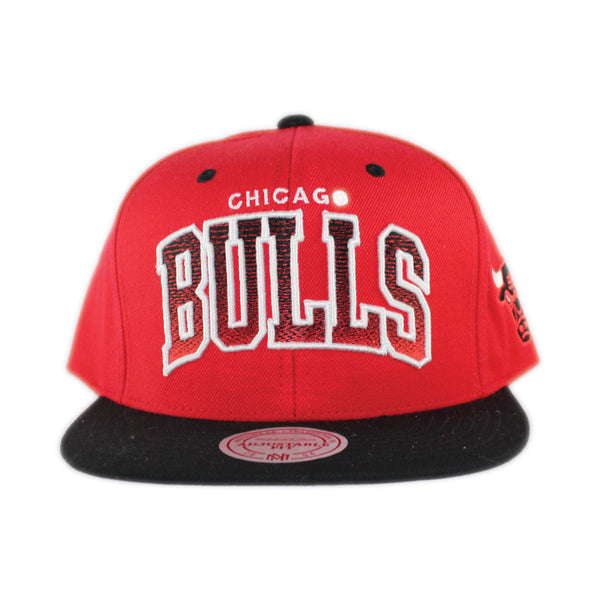 www.levels613.com Class: Men's Adjustable Snapback Hat Fabric: 80% Acrylic/20% Wool Detail Print: Bulls Script in Gradient Black to Red Color, Team Logo on Left Side, Mitchell & Ness Embroidered at Back Color: Red Dome, Black Visor Size: O/S Comfortable Authentic High-Quality Long Lasting Fresh All-Season Summer Gear Streetwear Unisex