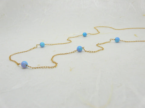 Delicate necklace with 5 opal beads
