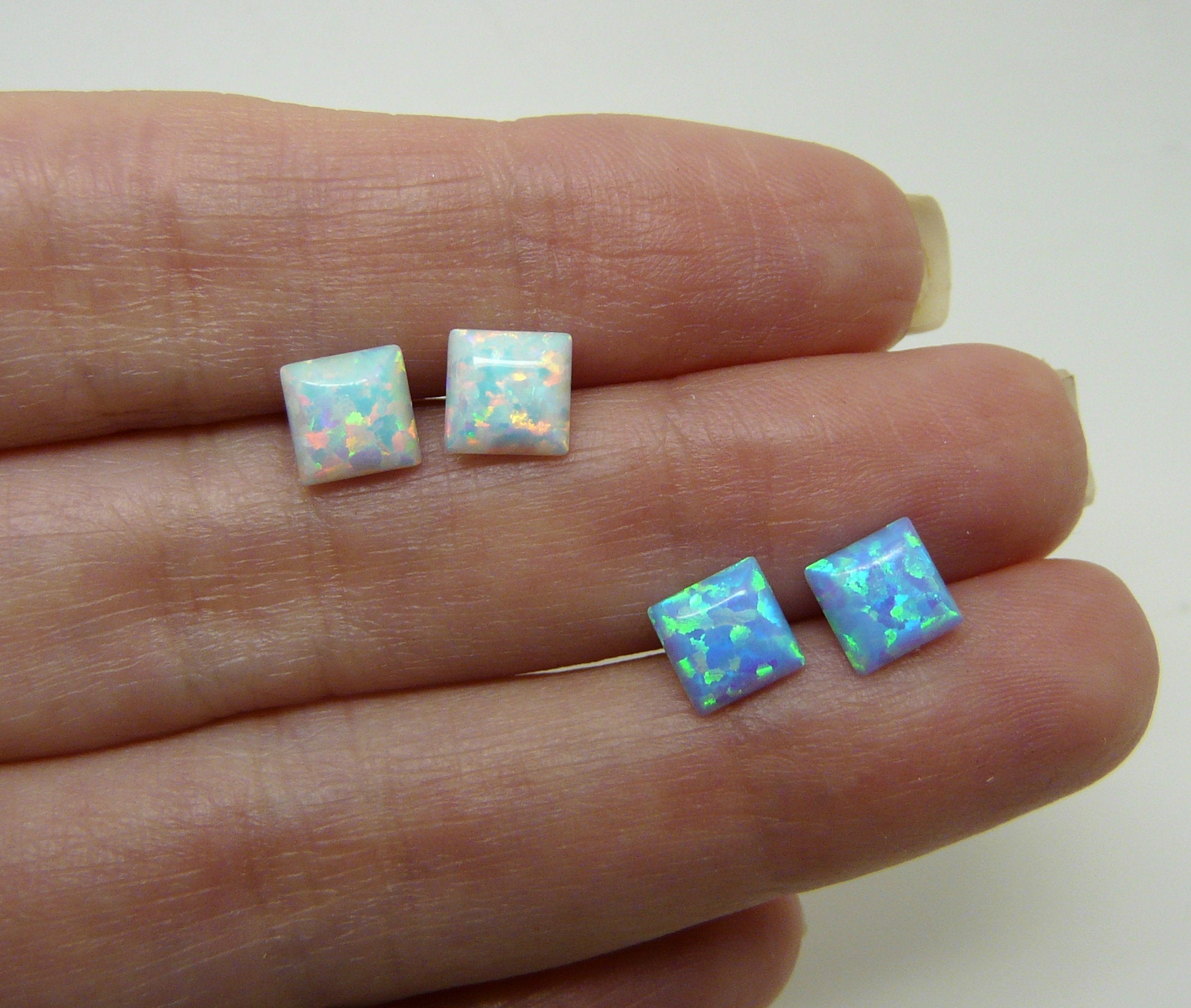 Post earrings with opal stone