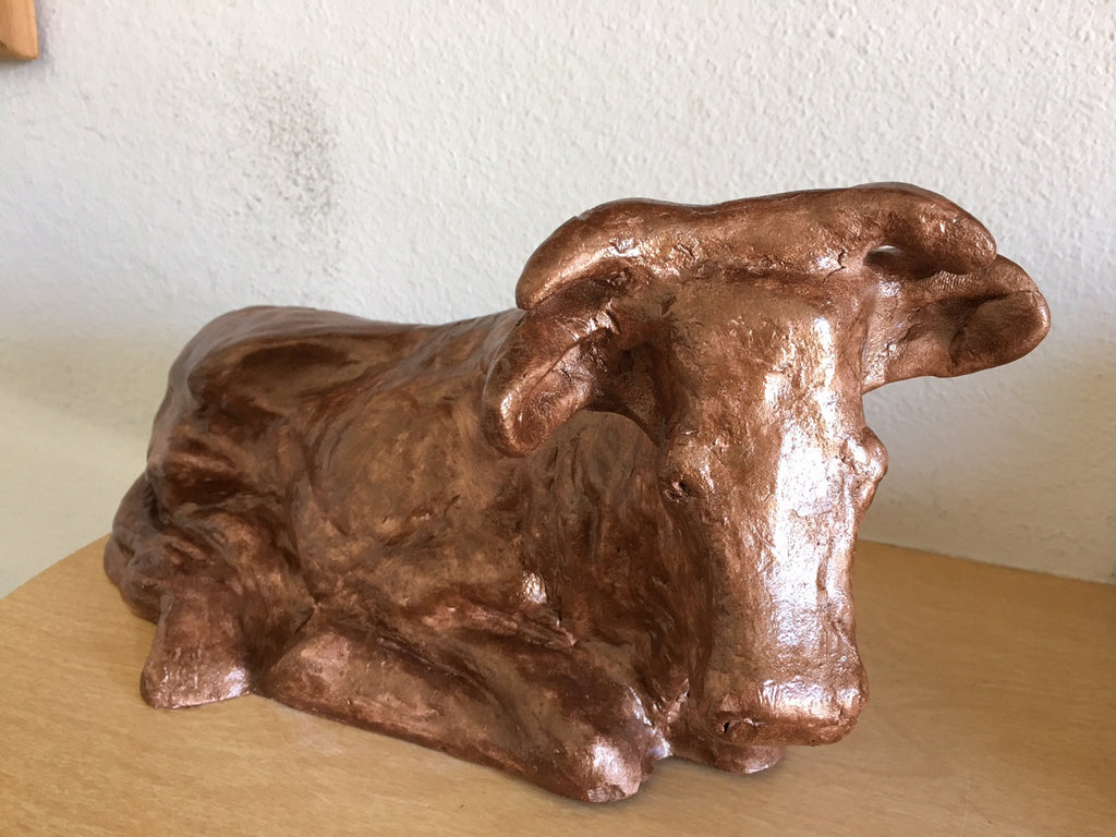 clay statue cow bull orange