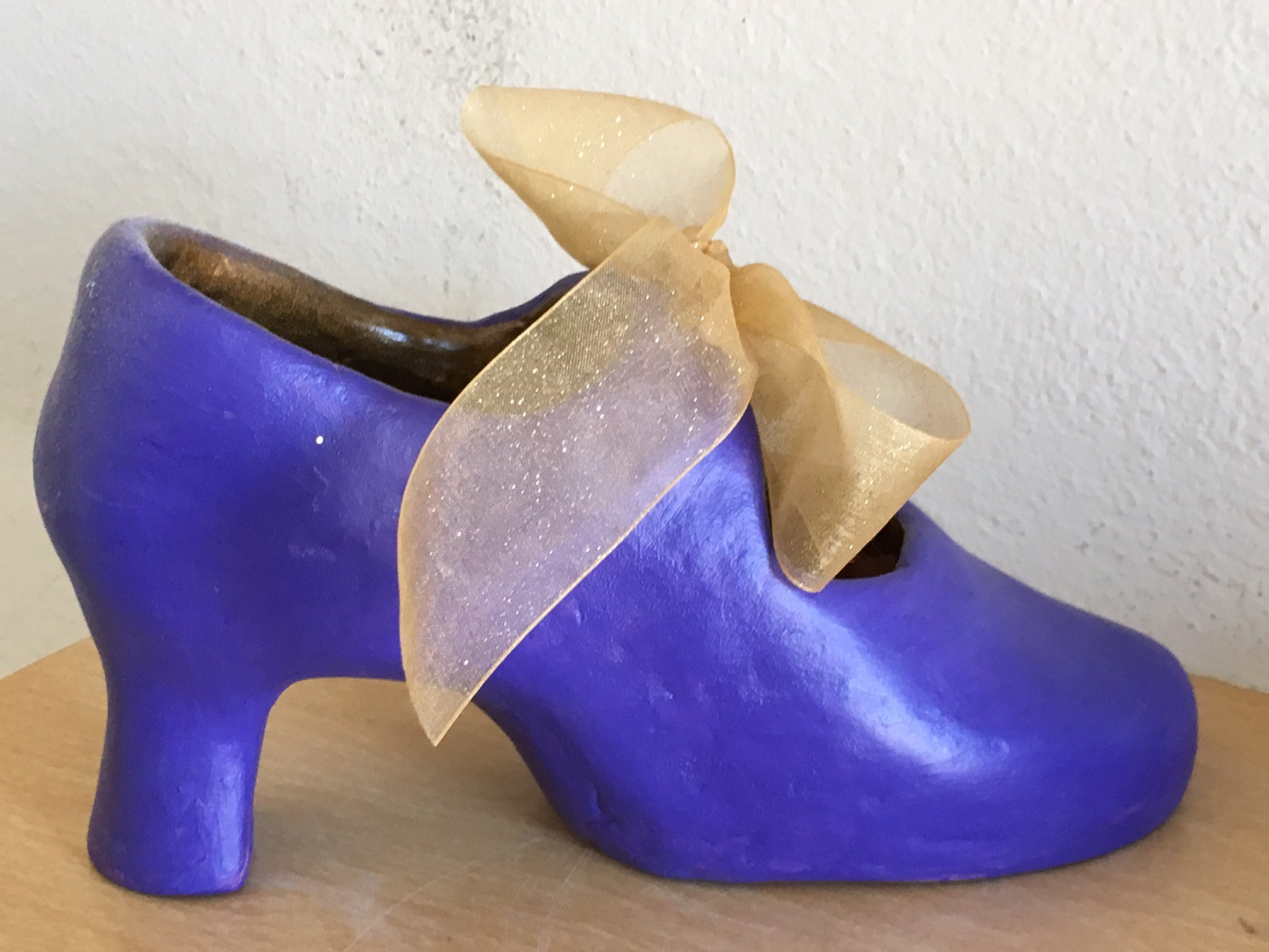 hand made womens shoe clay statue